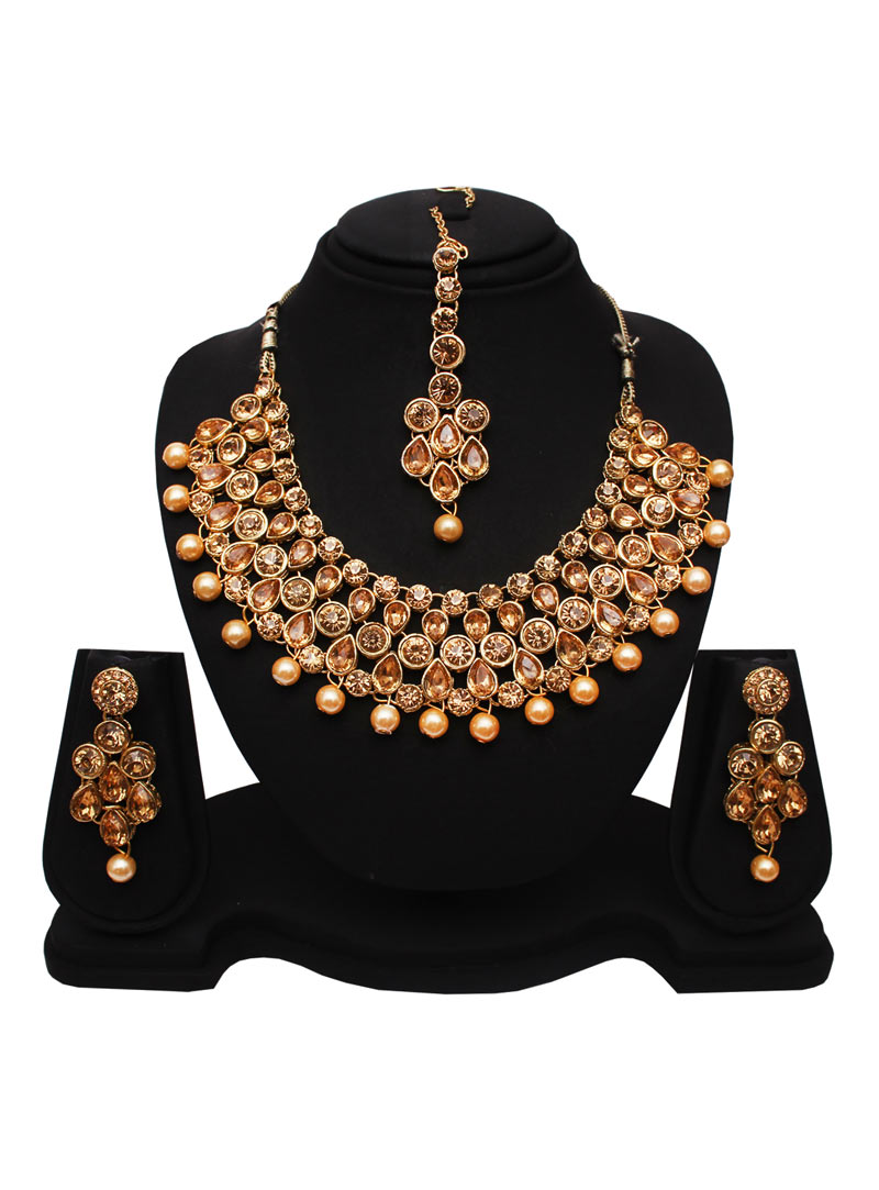 Golden Alloy Austrian Diamonds Necklace With Earrings and Maang Tikka 89175