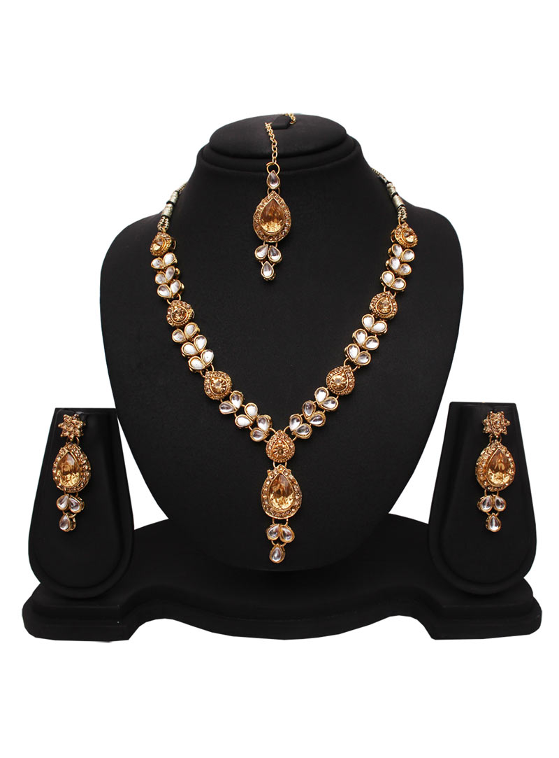 Golden Alloy Austrian Diamonds Necklace With Earrings and Maang Tikka 89181