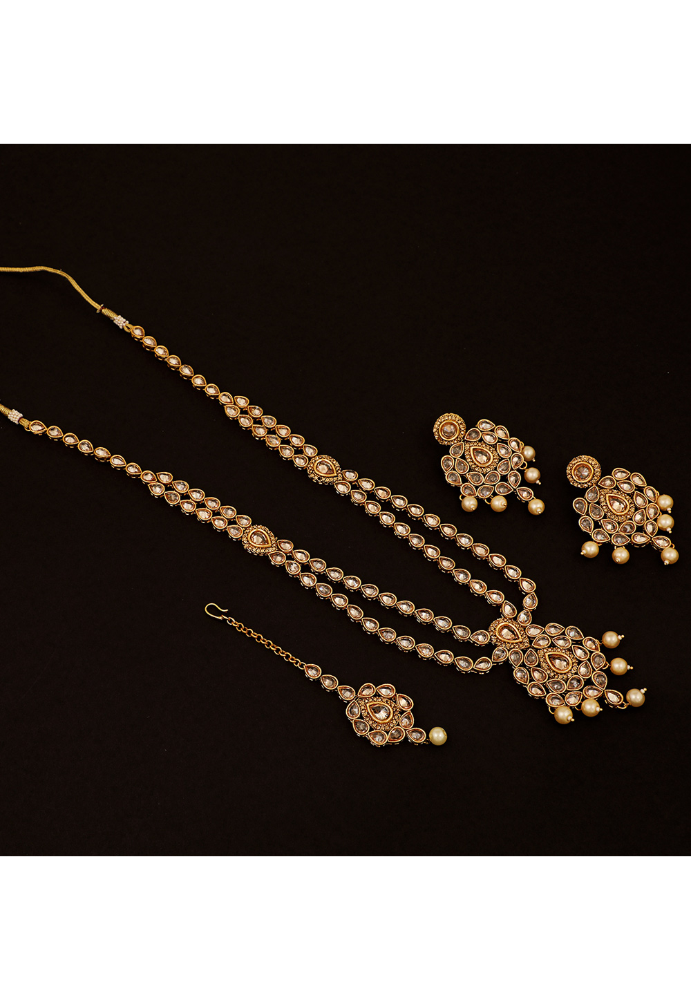 Golden Brass Pearl Long Set With Earrings and Maang Tikka 161179